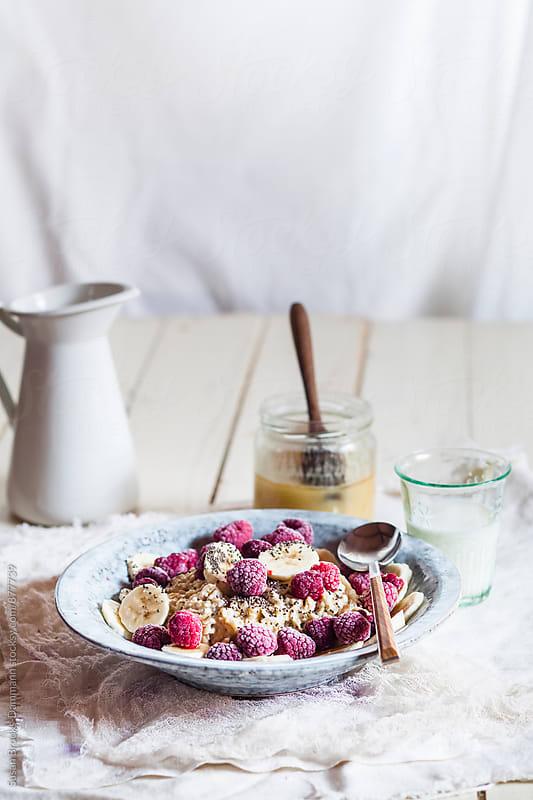 Porridge with fresh fruits by Susan Brooks-Dammann for Stocksy United