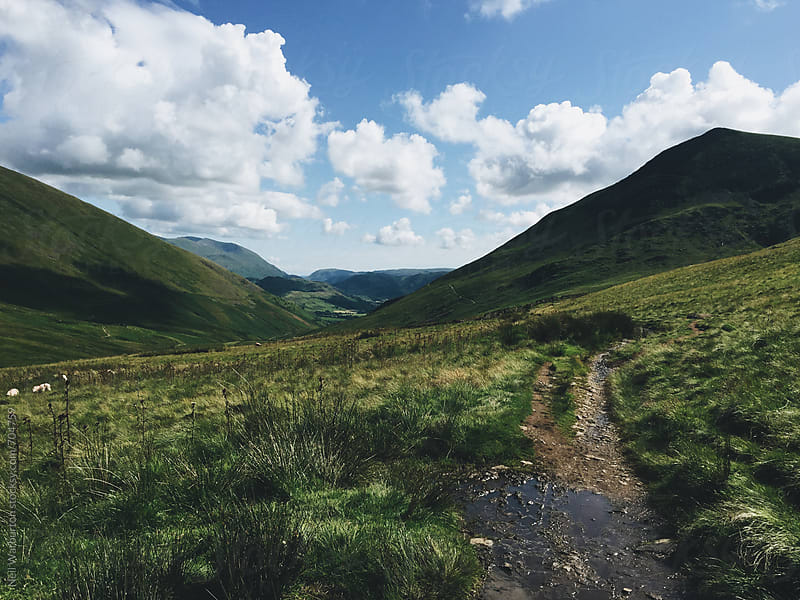 A trail across a Lake District landscape by Neil Warburton for Stocksy United