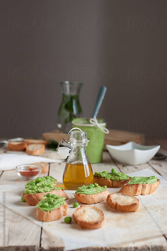 Crostini with peas cream by Nataša Mandić for Stocksy United