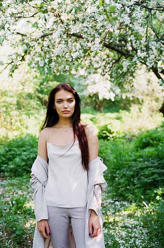 Young woman at the garden by Lyuba Burakova for Stocksy United