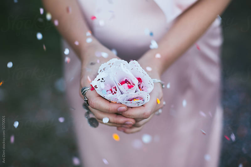 Woman holding cone with confetti by Ani Dimi for Stocksy United