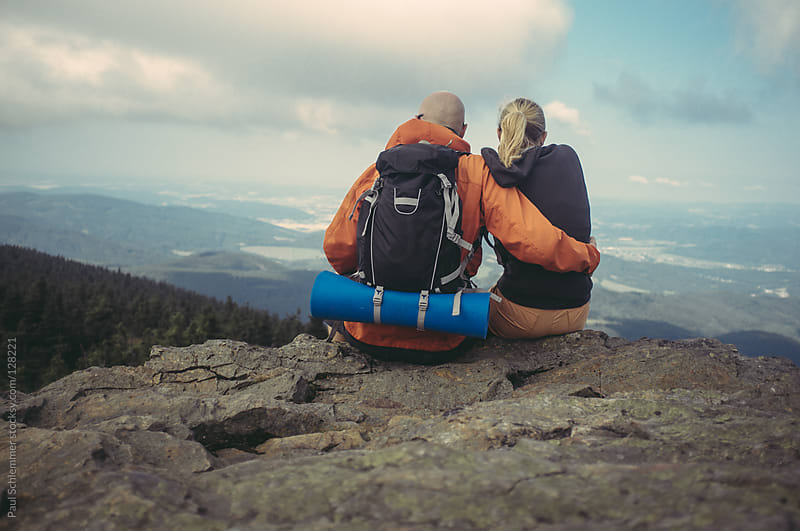 Couple of hikers  enjoying the view by Paul Schlemmer for Stocksy United