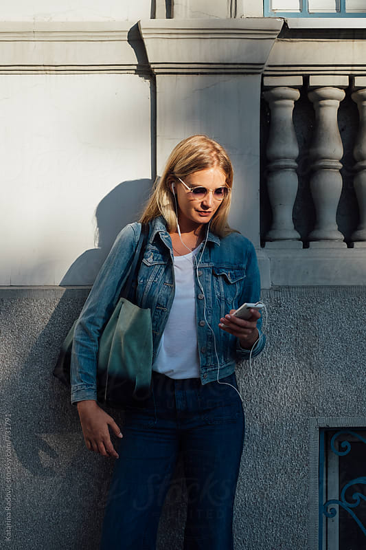 Blonde Woman Chatting on the Phone by Katarina Radovic for Stocksy United