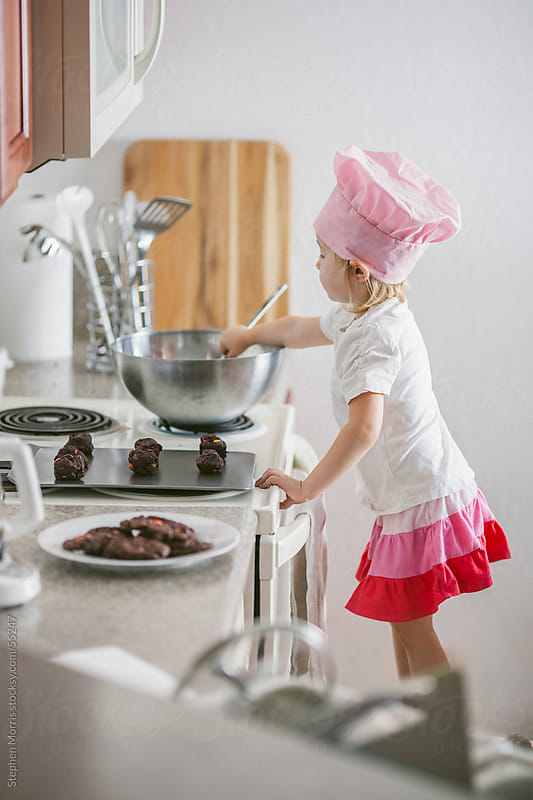 Little Girl Helping Make Cookies by Stephen Morris for Stocksy United