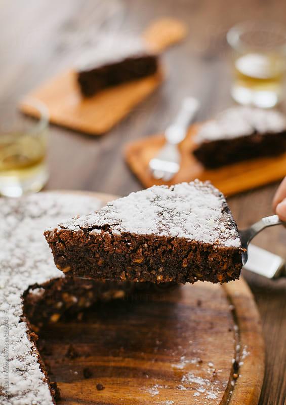 Slice of chocolate cake by Davide Illini for Stocksy United
