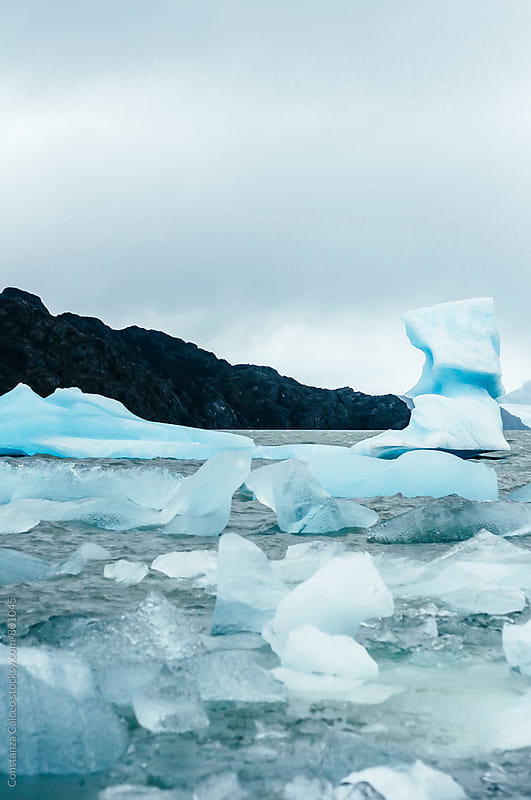 Various big  rocks of ice on a lake  by Constanza Caiceo for Stocksy United