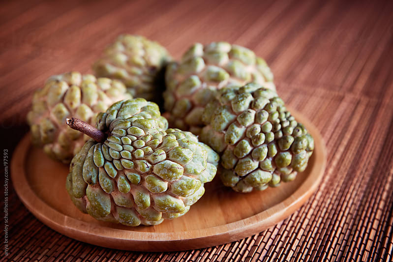 Sugar apple fruit on wooden plate by anya brewley schultheiss for Stocksy United