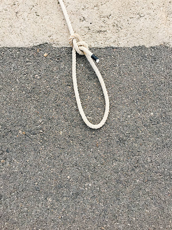 Rope tied into a lasso or loop by Darren Seamark for Stocksy United