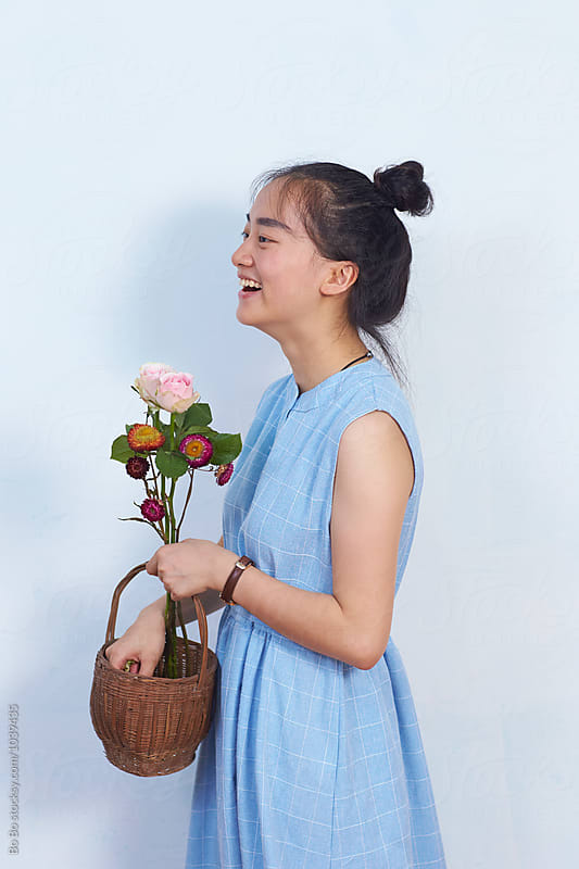 pretty young asian florist in her studio by cuiyan Liu for Stocksy United