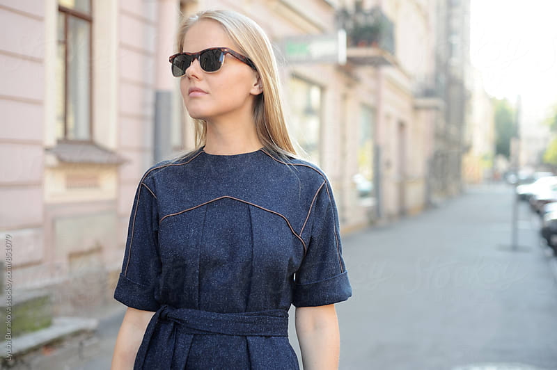 Young woman wearing sunglasses by Lyuba Burakova for Stocksy United