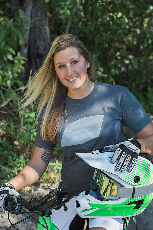 Portrait of a female mountain biker by Adam Nixon for Stocksy United