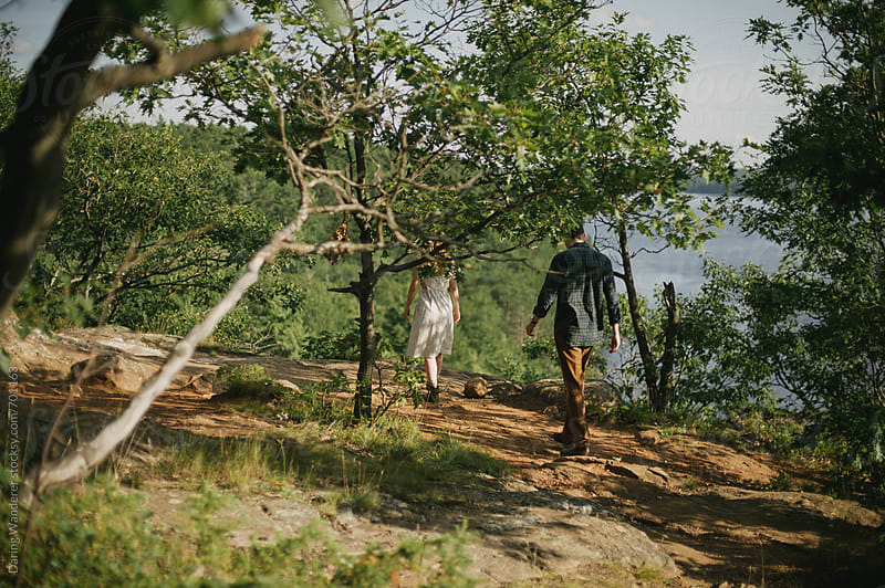 Young adventurous engaged couple exploring forest and cliff at Bon Echo Provincial Park by Daring Wanderer for Stocksy United