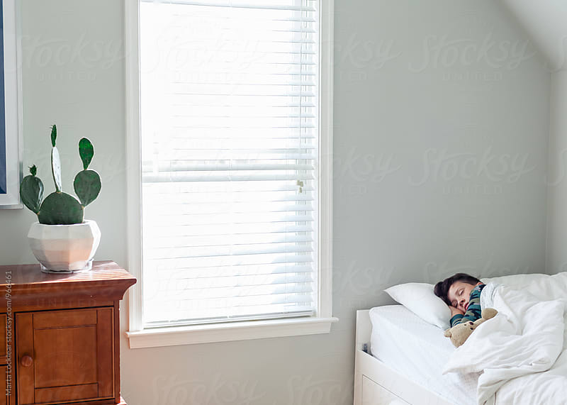 Boy sleeping in his room by Marta Locklear for Stocksy United