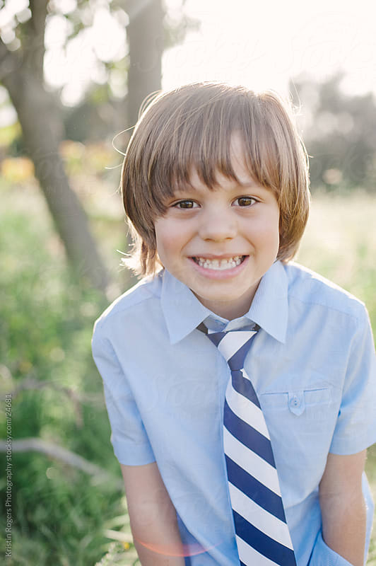 Young boy playful portrait by Kristin Rogers Photography for Stocksy United
