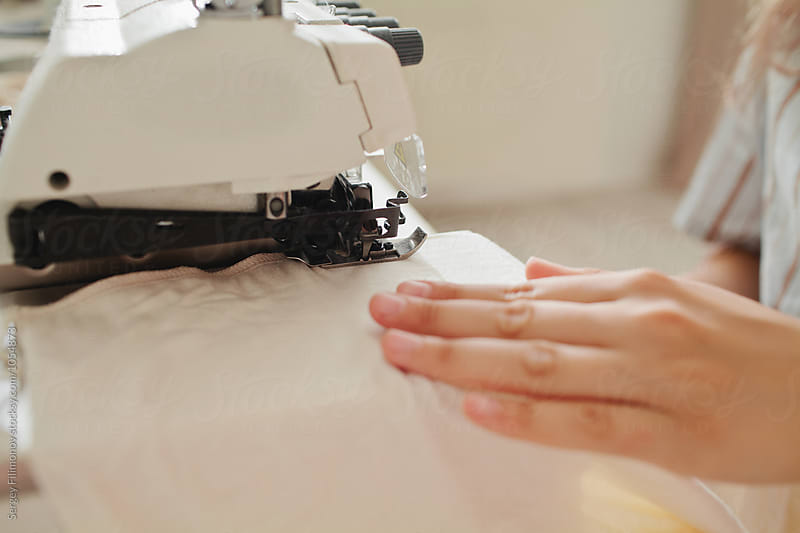 Woman tailor working with a sewing machine by Sergey Filimonov for Stocksy United