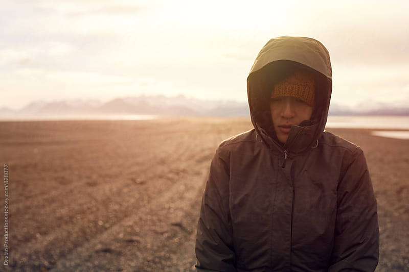 Portrait of cold traveller by Daxiao Productions for Stocksy United