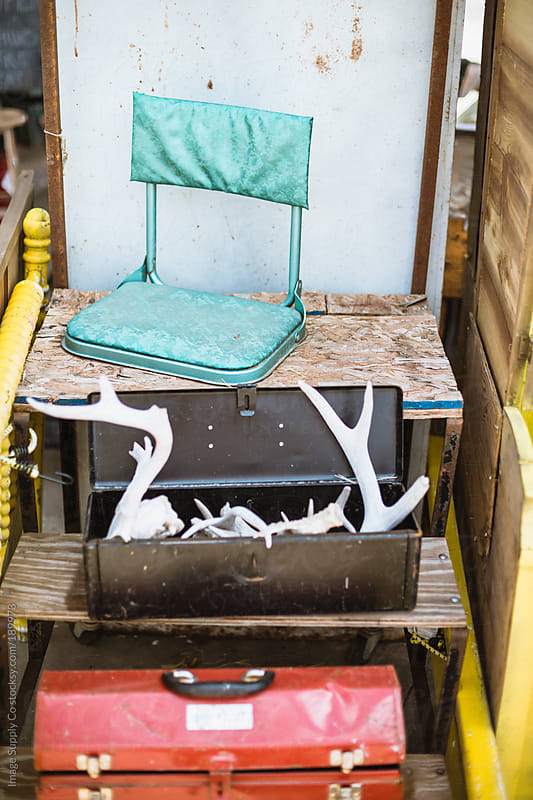 seat and antlers in a toolbox on stairs by Image Supply Co for Stocksy United