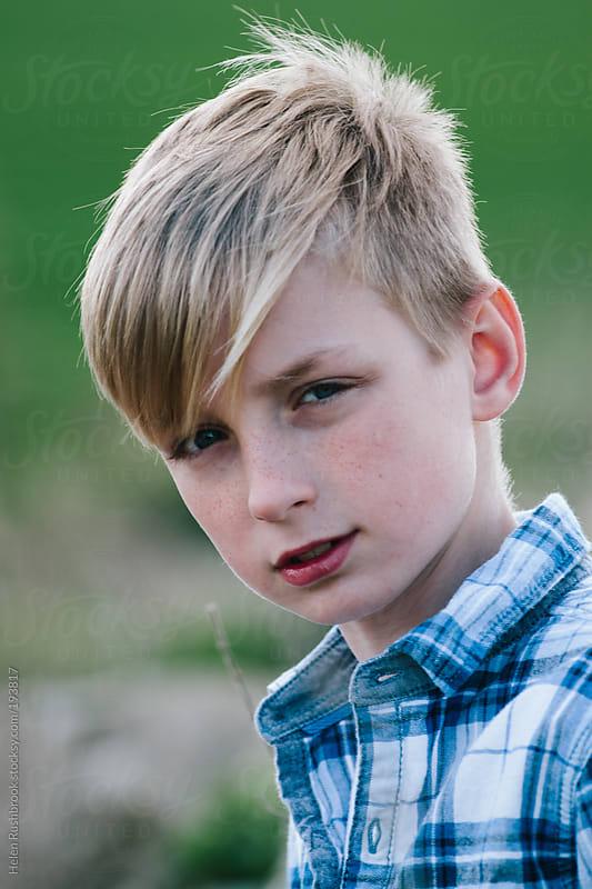 Trendy pre-teen boy by Helen Rushbrook for Stocksy United