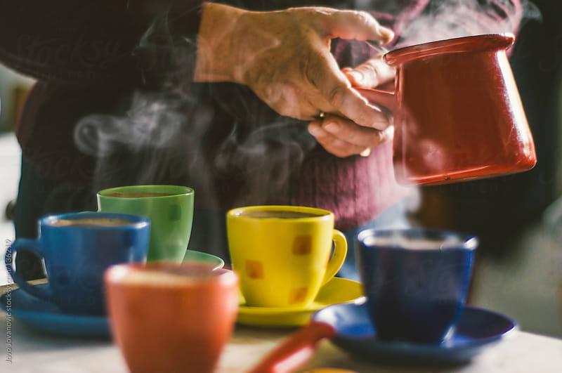 Grandma serving hot coffee. by Jovo Jovanovic for Stocksy United