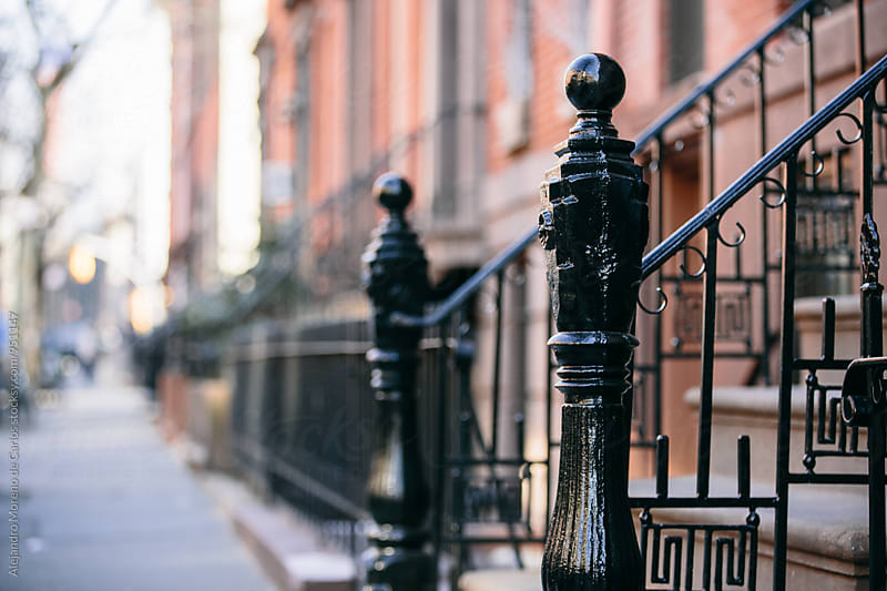 Close-up of black railings in the street by Alejandro Moreno de Carlos for Stocksy United