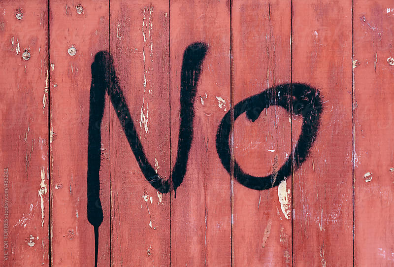 NO Message Painted on a Red Wooden Wall by VICTOR TORRES for Stocksy United