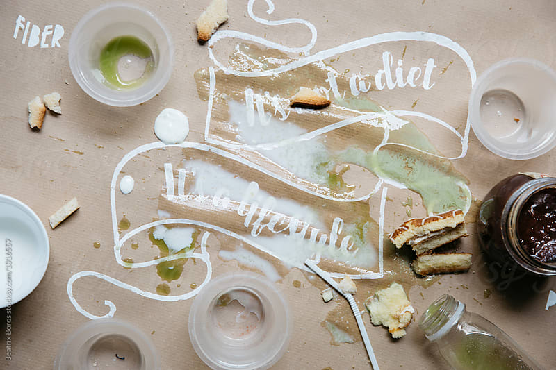 Unhealthy messy table with a failed attempt to be healthy by Beatrix Boros for Stocksy United