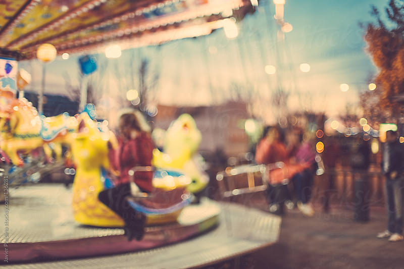 Carousel with children enjoying by Javier Pardina for Stocksy United
