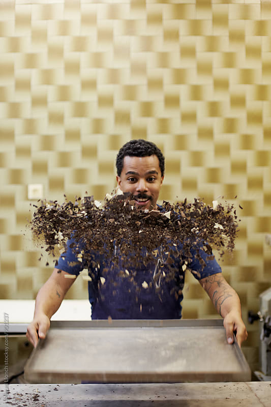 Funny portrait of food artisan playing with the chocolate  by Miquel Llonch for Stocksy United