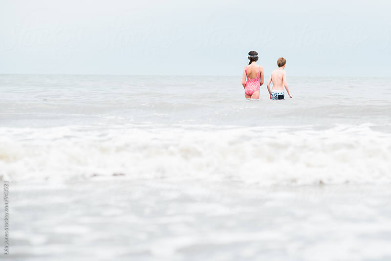 kids in ocean by Léa Jones for Stocksy United