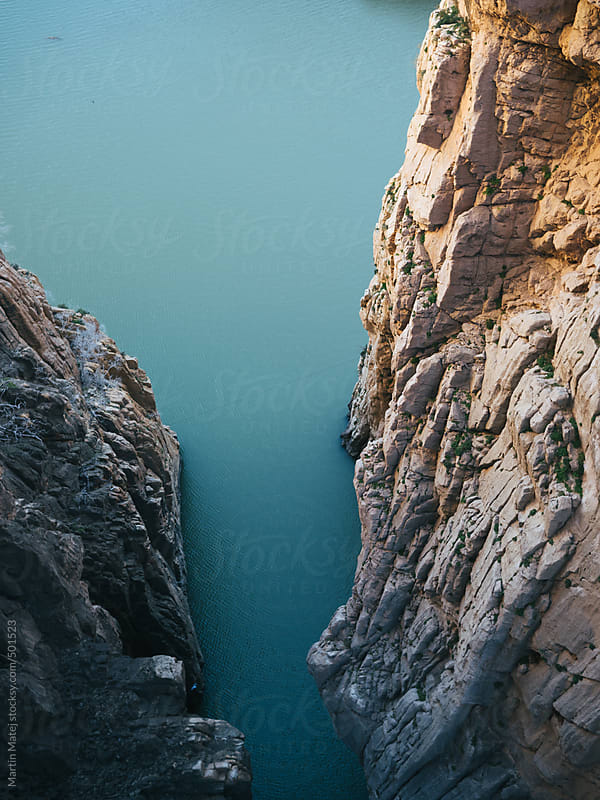 River flowing under camino del rey pathway by Martin Matej for Stocksy United