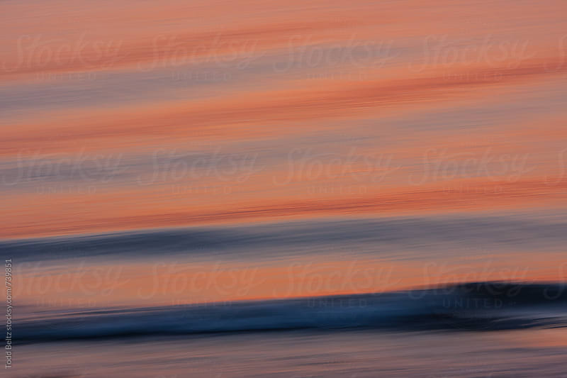Ocean waves at sunset. In-camera motion blur.  by Todd Beltz for Stocksy United
