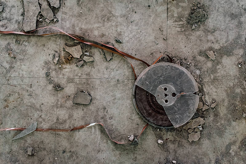 Old movie tape on the ground by Boris Jovanovic for Stocksy United