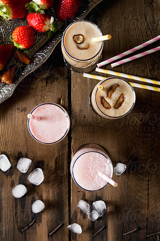 Date and strawberry milkshake by Pixel Stories for Stocksy United