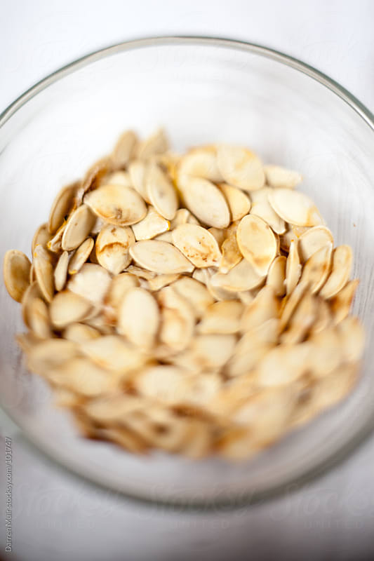 Roasted pumpkin seeds. by Darren Muir for Stocksy United