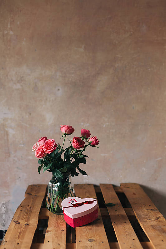 Bouquet of roses and a Valentine's gift on the table  by Marija Mandic for Stocksy United