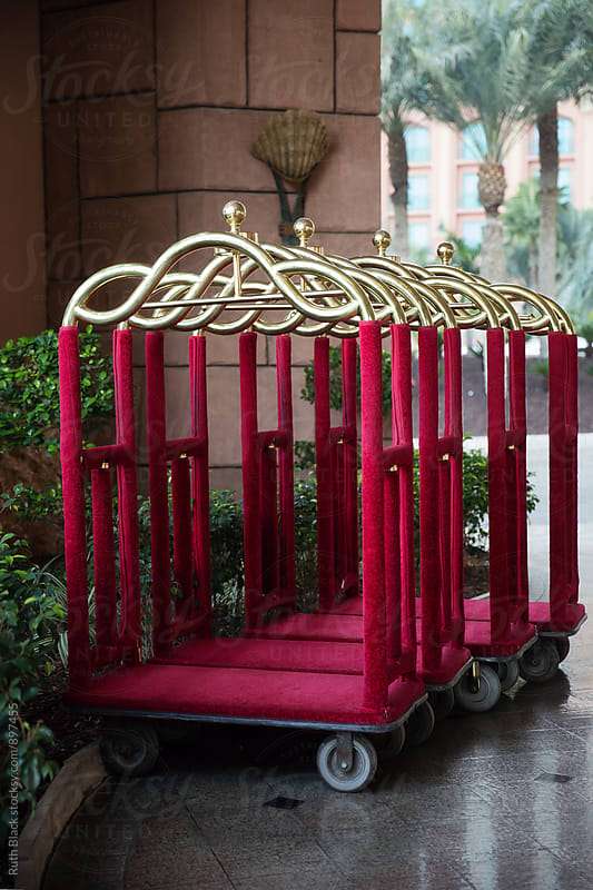 Hotel luggage trolleys by Ruth Black for Stocksy United