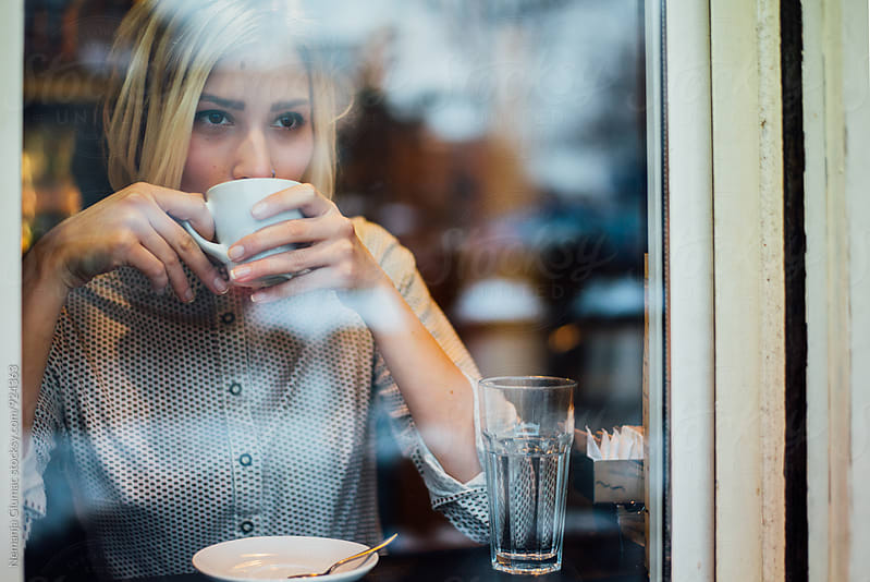 Pretty Blond Woman Drinking Coffee by Nemanja Glumac for Stocksy United