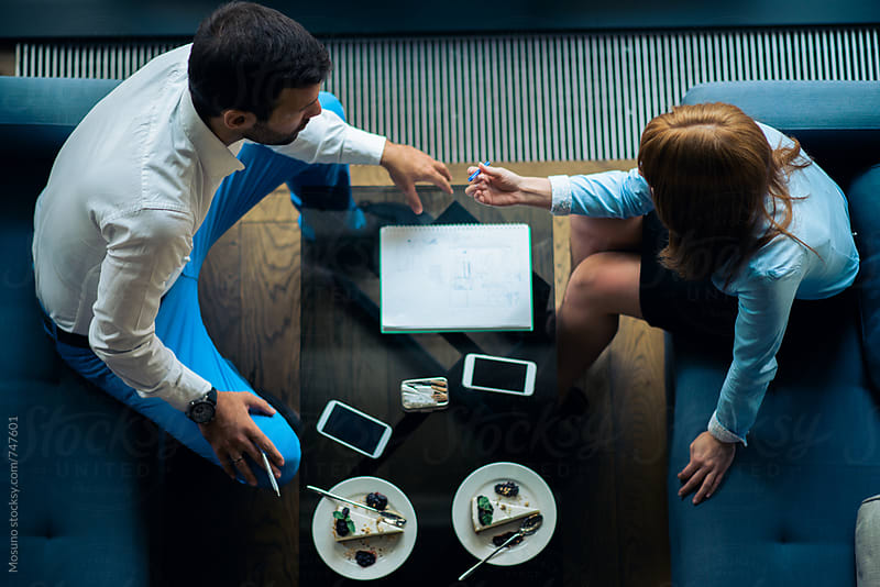 Overhead Shot of Two People in a Business Meeting by Mosuno for Stocksy United