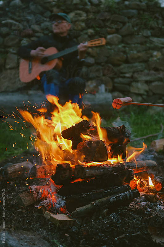 european campfire grilling by Paul Schlemmer for Stocksy United