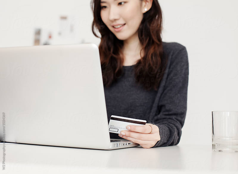 Young woman using credit card to make an online purchase. by W2 Photography for Stocksy United
