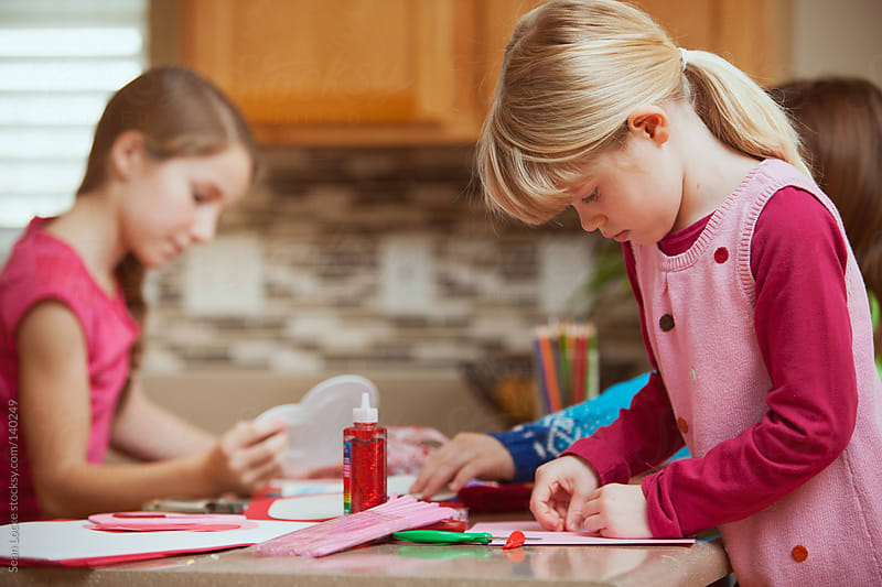 Valentine: Girls Working On Valentine Crafts by Sean Locke for Stocksy United