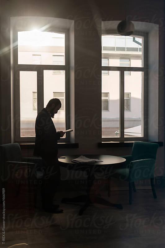 Man standing near table by Danil Nevsky for Stocksy United