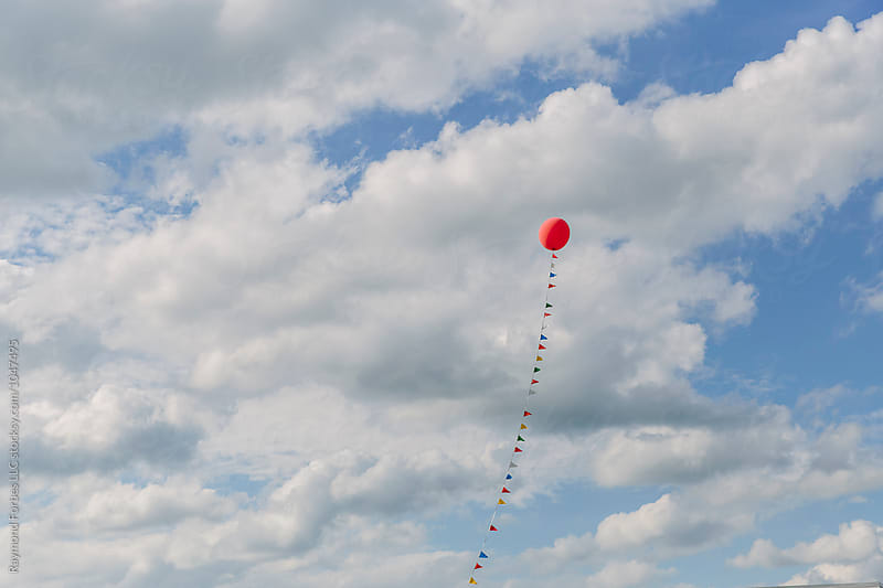 Lonely Balloon above Car Dealership by Raymond Forbes LLC for Stocksy United