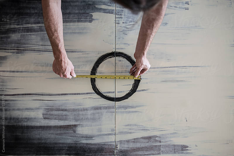 Artist Measuring Painted Circle  by Cameron Whitman for Stocksy United