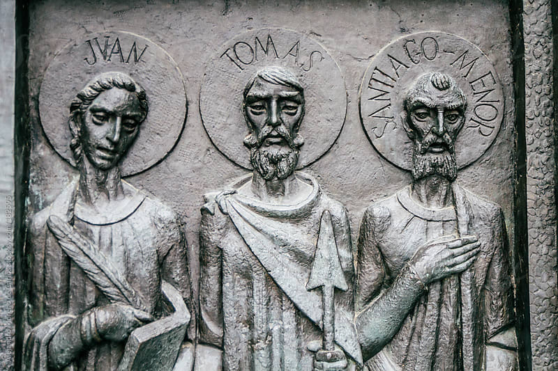 Relief sculpture of three apostles on christian cathedral by Alejandro Moreno de Carlos for Stocksy United