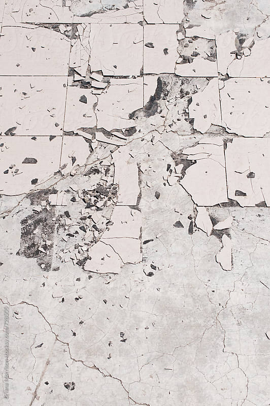 Old Broken White Tile on Concrete by Briana Morrison for Stocksy United