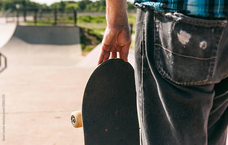 Skateboarder Holds Board Before Hitting Ramp by Sean Locke for Stocksy United