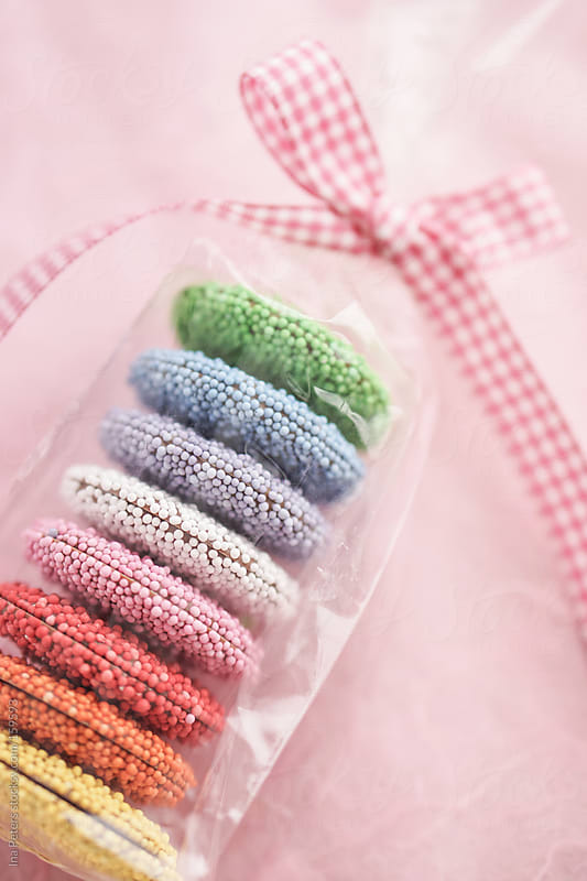 Food: Colorful little Chocolates in a Bag with Bow by Ina Peters for Stocksy United