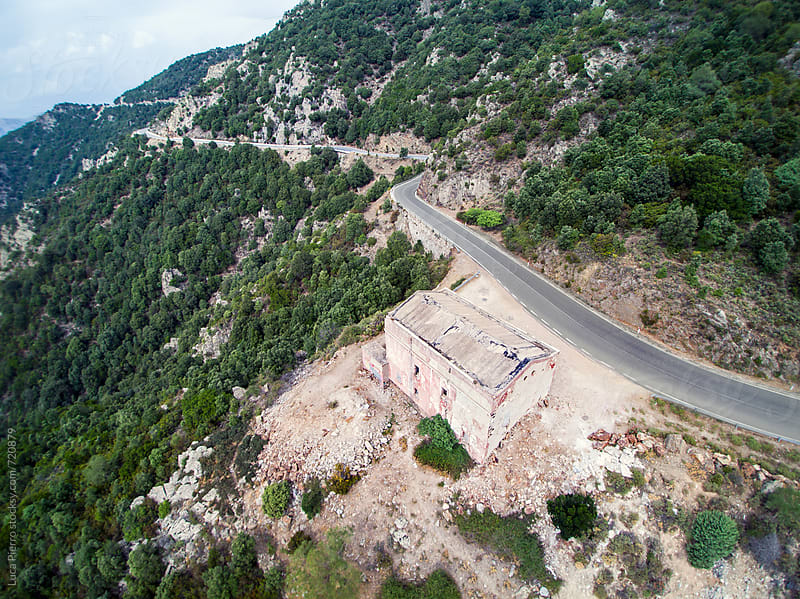 Aerial view of a road on a mountain, Sardinia by Luca Pierro for Stocksy United