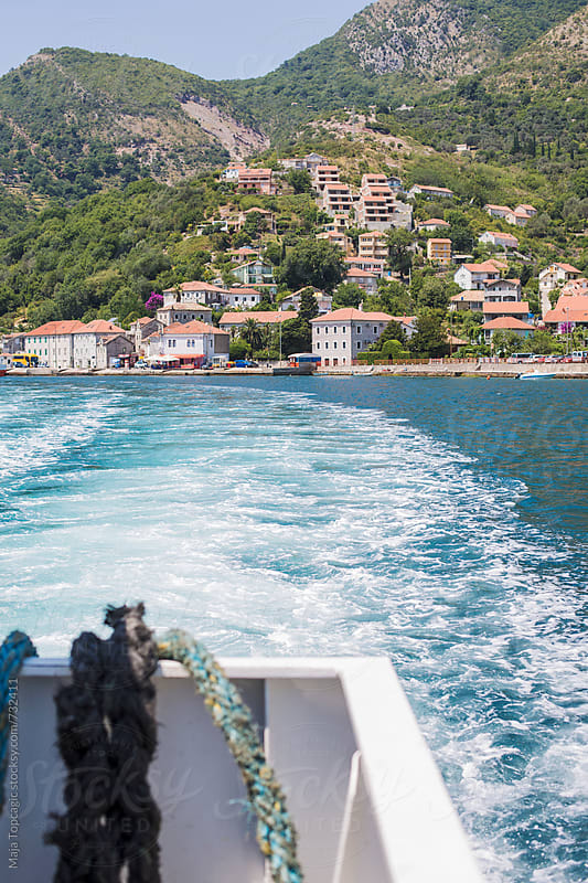 Ferry boat going away from a seaport in Budva by Maja Topcagic for Stocksy United
